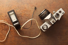 Old analogue camera with flash Royalty Free Stock Photo