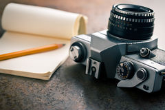 Old analogue camera and notepad Stock Photos