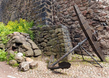 Old anchor on a background of the fortress wall Stock Photos