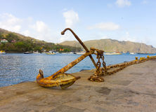 An old anchor in the caribbean Stock Images