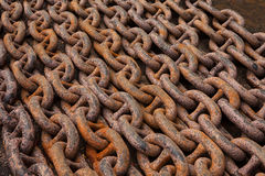 Old anchor chains, heavy, powerful, rusty, steel, lying in rows stock images