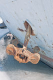 Old anchor closeup. Old rusty anchor on the bow of the ship frozen into the ice. Close-up Royalty Free Stock Photo