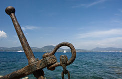 Old anchor with sea view Stock Photos