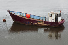 Old anchored boat Royalty Free Stock Photos
