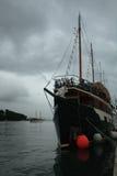 Old anchored ship and upcoming storm Royalty Free Stock Image
