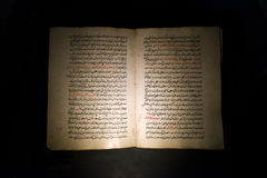 Old Ancient Book With Arabic Text. Old ancient book with Middle Eastern Arabic text. The scene provides for a dark , moody, and mysterious feeling. Kind of has Stock Photo