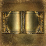 Old ancient book with gold pages. On the abstract background Stock Images
