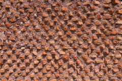 Old ancient brick wall   composed of thin clay bricks placed at Royalty Free Stock Photo