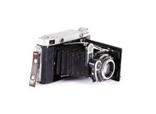 Old ancient camera. Black isolated stock image
