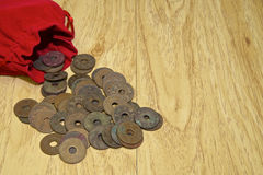 Old ancient coins of Thailand with red bag Stock Image