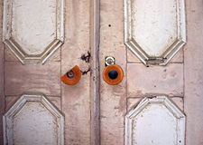 Old ancient door with a broken knob handle Royalty Free Stock Image