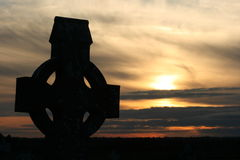 Old Ancient Irish Celtic Cross. An Old Irish Celtic Cross against a beautiful Sunset Royalty Free Stock Image