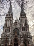 Old ancient medieval gray creepy scary catholic, orthodox Gothic church with spiers. European architecture.  stock photo