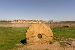 The old ancient millstone in the national-historical and archaeological reserve Stone Tomb , Ukraine Royalty Free Stock Images