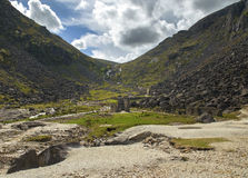 Old ancient mine with buildings Glendalough valley, Ireland. There has been a lot of mining activities in de the early ages royalty free stock photo