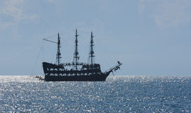 Old ancient pirate ship silhouette on the sea. Royalty Free Stock Images