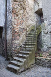 Old ancient stone made stairlead to a door Royalty Free Stock Images