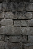 The old and ancient stone wall of a building.  Stock Photo
