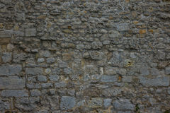 The old and ancient stone wall of a building.  Stock Photography