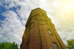 Old ancient tower from red brick, against overcast sky. Old ancient tower from red brick, against overcast sky royalty free stock images