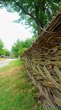 Old ancient Ukrainian wicker by hands fence in the village stock photos