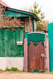 Old ancient wicket door with an old fence, the rustic house Stock Photo