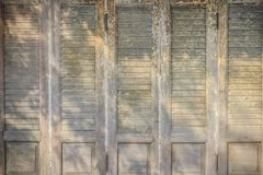 Old ancient wooden swing door background. Vintage of old wooden Royalty Free Stock Images