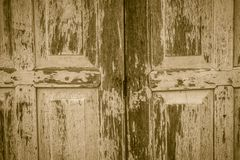 Old ancient wooden swing door background. Vintage of old wooden Stock Photography