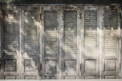 Old ancient wooden swing door background. Vintage of old wooden Stock Images