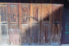 Old ancient wooden swing door background. Vintage of old wooden Royalty Free Stock Photos