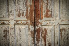 Old ancient wooden swing door background. Vintage of old wooden Royalty Free Stock Image