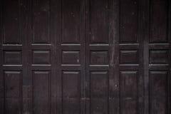 Old ancient wooden swing door background. Vintage of old wooden stock image