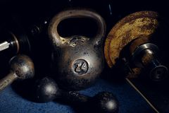 Old And Heavy Kettlebell Weight In Dark Room Royalty Free Stock Photo