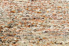 Old And Weathered Grungy Red Brick Wall Partly Covered By Excess Cement And Grey Paint Stock Photo