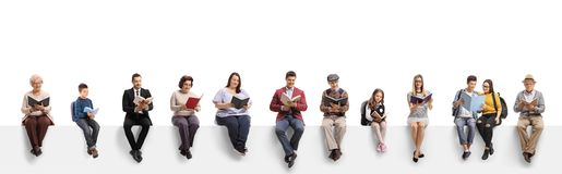 Free Old And Young People Sitting On A Banner Reading Books Royalty Free Stock Photography - 157755947