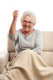 Old angry woman smiling and threatening with fist Royalty Free Stock Photo