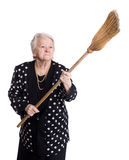 Old angry woman threatening with a broom Royalty Free Stock Images