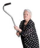 Old angry woman threatening with a cane Royalty Free Stock Images