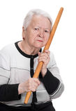 Old angry woman threatening with a rolling pin Royalty Free Stock Photography