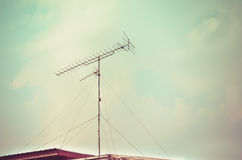 Old antenna with blue sky background. Silhouetted image Royalty Free Stock Photography