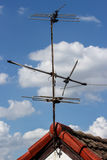 The old antenna on roof. With cloud and blue sky background Royalty Free Stock Photo