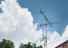 Old antenna for television with blue sky Stock Photos