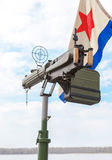 Old anti-aircraft machine gun Maxim in the background of the fla Royalty Free Stock Images