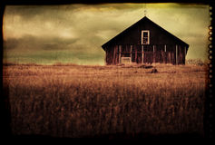 Old antique barn in field Royalty Free Stock Images
