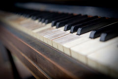 Old or antique black and white piano keys with wood grain, close-up and selective focus Stock Photos
