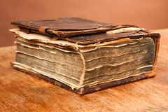 Old antique book on table Stock Images