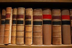 Old Antique Books. Old worn out books on a shelf royalty free stock photo