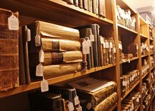 Old Antique Books and Bibles Amish and Mennonite. Shelves sitting full of antique books in a museum dedicated to Amish and Mennonite Heritage - old bibles and royalty free stock image