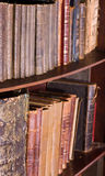 Old antique books at bookstore or library royalty free stock images