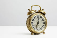 Old antique brass alarm clock Stock Images